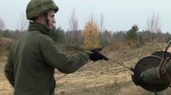Lithuania Rukla, November 2015, Lithuania Soldiers Roll Up A Wire Explosives - stock footage
