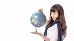 Asian woman looking at spinning globe cinemagraph - stock footage