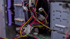 Checking the wires and unplugging them Stock Footage