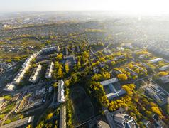 Aerial city view with crossroads, roads, houses, buildings and parks - stock photo