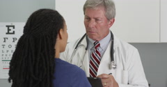Senior doctor listening and being positive to patient Stock Footage