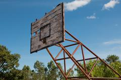 Basketball hoop is broken and wood board damaged ,Shiny wooden basketball - stock photo