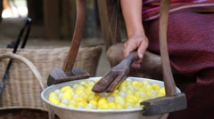 Stock Video Footage of Traditional silk keeping by boiling silk cocoon.