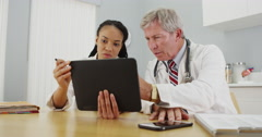 Doctors working together in the office - stock footage