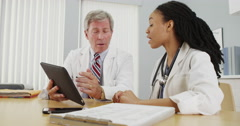 Two doctors working together in the office - stock footage