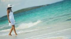 Ethnic Hispanic female in white dress on vacation ocean beach Stock Footage