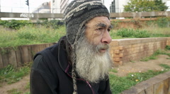 Footage of a real homeless man living in the street - stock footage