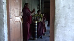 Buddhist Monks preparing butter tea. Stock Footage