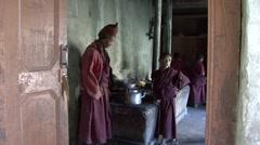 Buddhist Monks preparing butter tea. Stock Footage