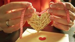 Beautiful young girl preparing a romantic gift for Valentine's day Stock Footage