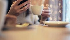 Woman hands texting, using smartphone in cafe - stock footage