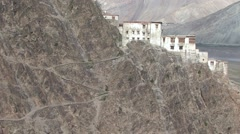 Karsha gompa monk walk on path to monastery 3 Stock Footage