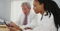 Two doctors using tablet in the office - stock footage