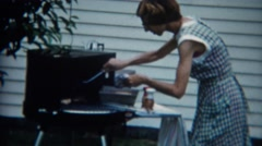 1957: Thin tall women grilling outdoor barbeque seasoning beef steak. DENVER, - stock footage