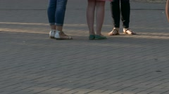 Ungraded: Legs of People Standing in Line at Box Office on Street in The - stock footage