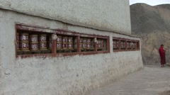 Lamayuru Buddhist Monastery monk walk and turn the praying bells. Stock Footage