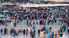 Jemaa el-Fnaa square in Marrakesh evening slow motion Stock Footage