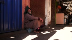 Beggar with splendid face on the street of Marrakesh - stock footage