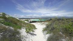 Walking Down Path Towards Beach in Galapagos Stock Footage