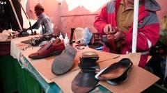 Shoeshine in Marrakesh Medina slow motion Stock Footage