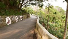 POV walk on twisting road on mountain side, Maokong area winding way Stock Footage