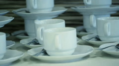 Many White Tea Cups in Table Stock Footage