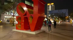 Red LOVE characters on night street of Taipei, backside, parallax shot Stock Footage