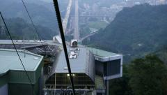 Approaching to gondola lift middle station, freeway aerial perspective Stock Footage