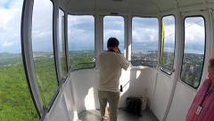 Man makes photo from the moving cable car gondola. Stock Footage