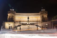 National monument of Victor Emmanuel II at night Stock Photos