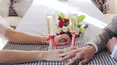 Gently connected hands of a newly-married couple with wedding rings on a finger Stock Footage