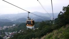 Aerial view from gondola lift slide down, evening time, mountains Stock Footage