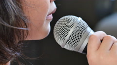 Close up shot of a cute little Asian girl singing - stock footage
