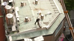 Man work pack and crane lift down steel battens from roof, time lapse Stock Footage