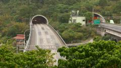 Car traffic rush from green mountain tunnel, time lapse shot Stock Footage