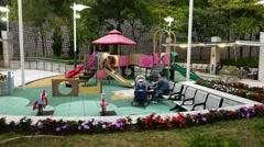 Children playground in park, parallax shot, move around, evening time Arkistovideo