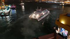 Catamaran ferry manoeuvre at night near wharf, time lapse - stock footage