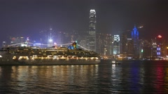 Cruise liner move backwards from pier, night asian city background Stock Footage