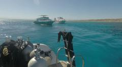 Reef and boats outside Giftun Island - Red Sea water Egypt Stock Footage