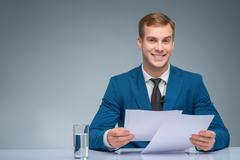 Smiling newscaster during broadcasting Stock Photos