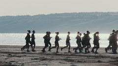 Group оf people running on the riverside,silhouette - stock footage