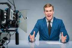 Newsman is extremely stressed out Stock Photos