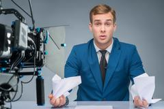 Newsman looks stressed out - stock photo