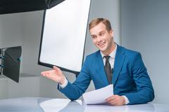 Newsman during shooting process - stock photo