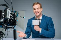 Newsman during broadcasting process - stock photo