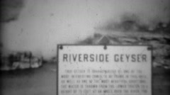 1937: Riverside geyser white steam smoke gas blows windy vapors.  YELLOWSTONE - stock footage