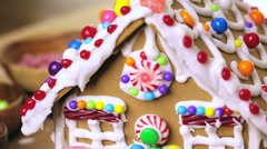 Building gingerbread house for Christmas. Stock Footage