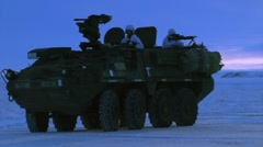 Alaska, November 2015, US Stryker Armed Vehicle Drive Snowy Area Soldiers - stock footage