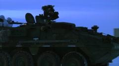 Alaska, November 2015, Close up US Stryker Armed Vehicle Drive Snowy Area Stock Footage