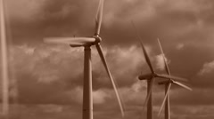 Sepia Wind turbine time lapse clouds turning renewable energy Stock Footage